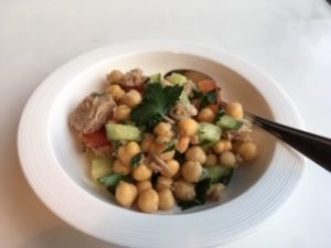 Mediterranean chickpea and tuna salad with chopped cucumber, tomato, parsley and lemon vinaigrette